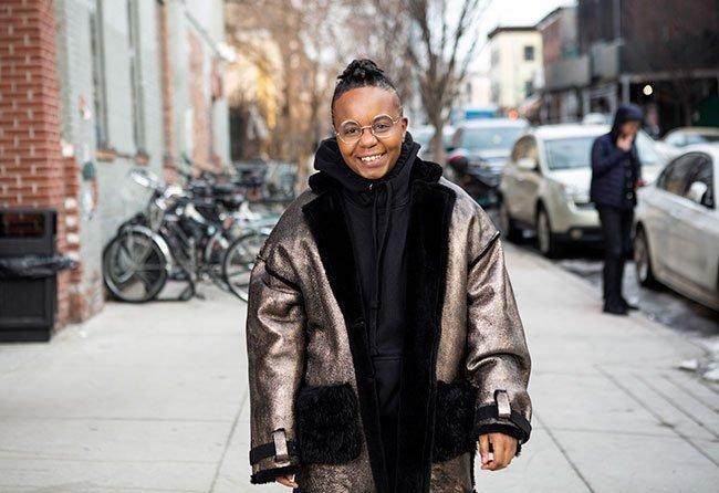 A transmasculine person walking home
