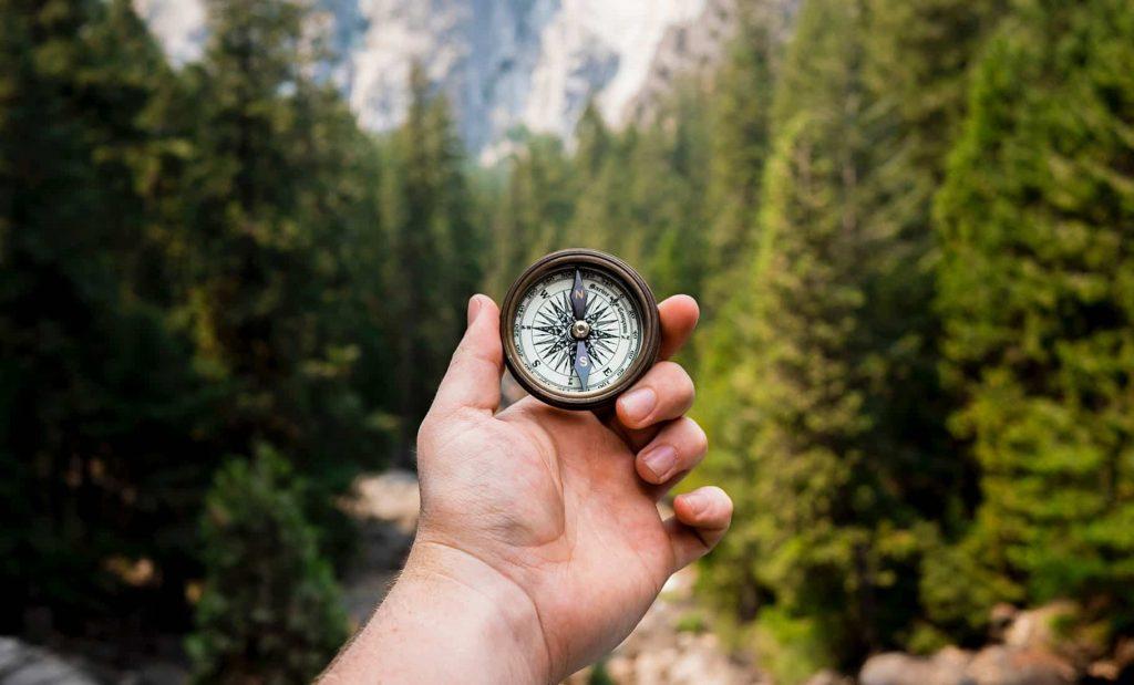 man w compass